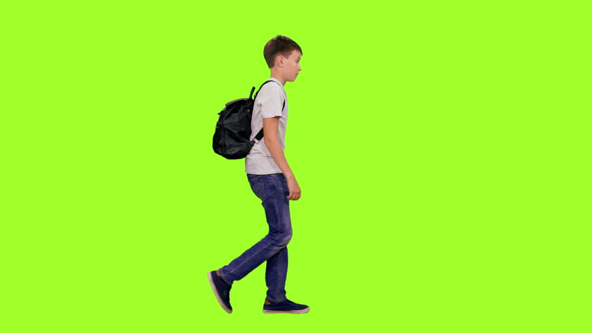 Schoolboy with backpack walking on green chroma key background, Side view, 4k pre-keyed footage