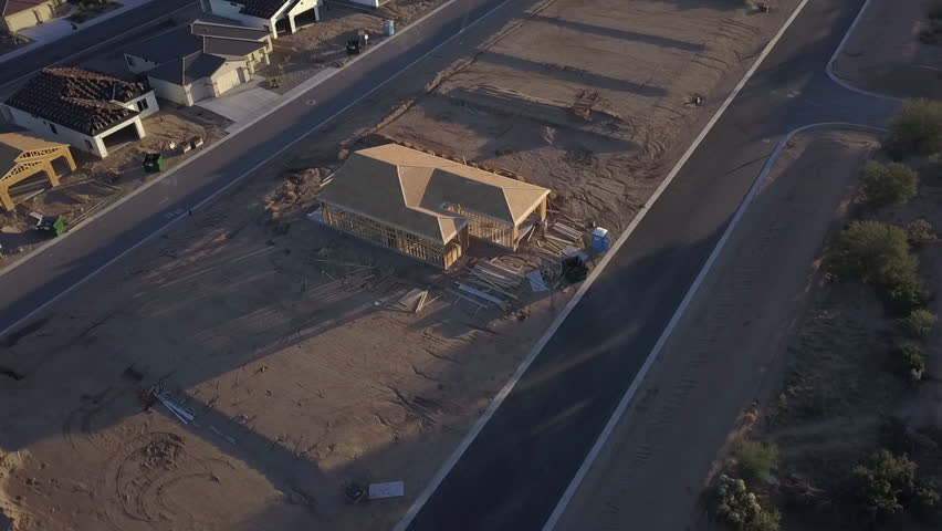 Aerial view of a house in the framing stage of construction #1017718810