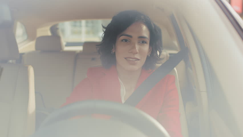 Portrait of Beautiful Young Woman Driving Car through Sunny Suburban Area. Camera Shot Made From the Front Windshield. | Shutterstock HD Video #1017759610
