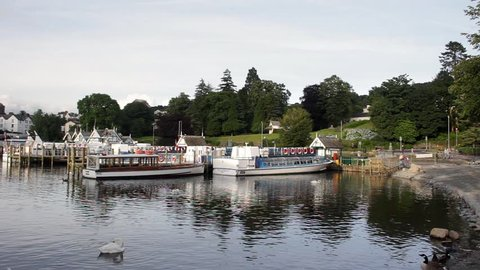 Windermere, Cumbria, UK. July 2017. Moored passenger cruiser boats Muriel II and Miss Cumbria III at Bowness-on-Windermere jetty, Lake Windermere in the Lake District. Muriel II was built in 1935.