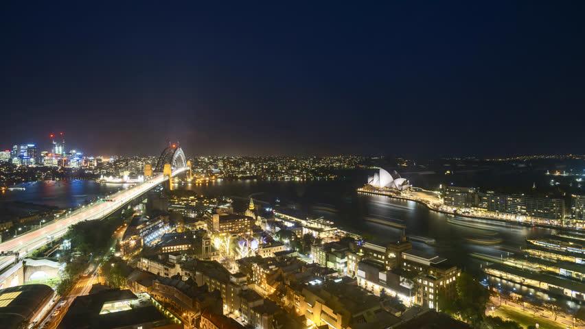 4k UHD time lapse of night scene at Sydney city skyline, aerial view. Tilt down | Shutterstock HD Video #1017828340