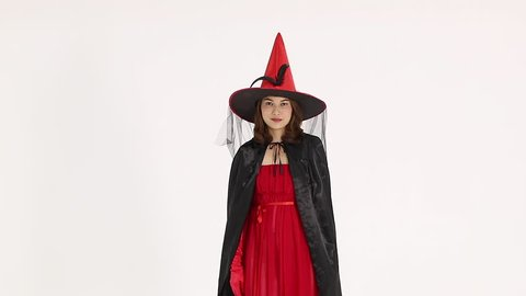 Woman in red female witch costume with high shape hat on white background.  Concept for 493cae0b5e2a
