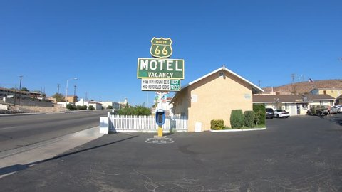 Barstow, California, USA - August 15, 2018: famous Route 66 Motel Sign, only renovated historic motel with vintage cars, in heart of Barstow on Route 66, the city's Main Street, San Bernardino County.