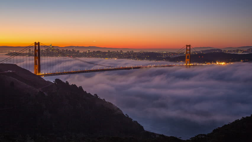 Time lapse clip of a fog at sunrise over the Golden Gate Bridge and San Francisco
