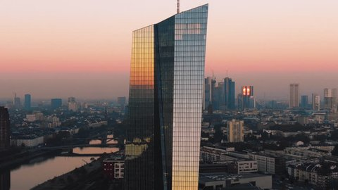 Frankfurt Skyline Aerial Shot at early sunrise reflecting sun in 4k