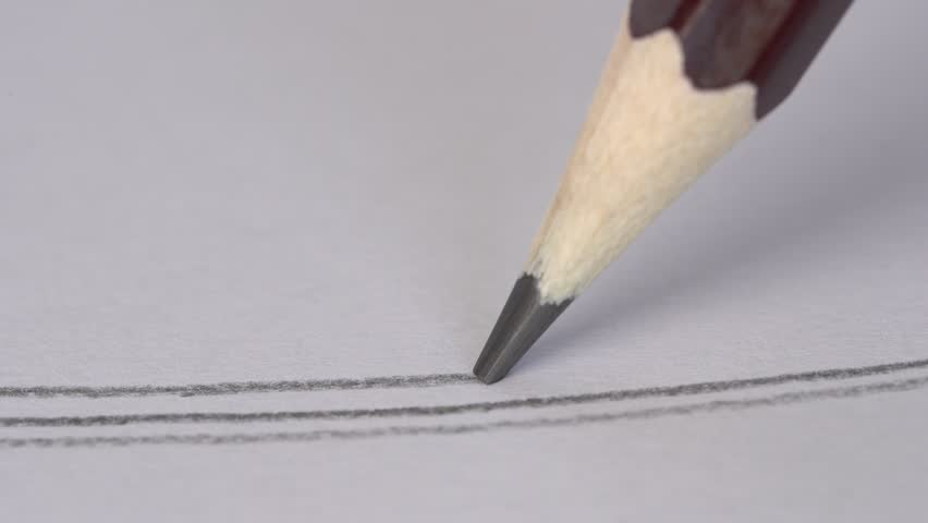 Artist hand drawing a flat gray line with a graphite wooden pencil on white paper. Close up, macro, 4k | Shutterstock HD Video #1017937660