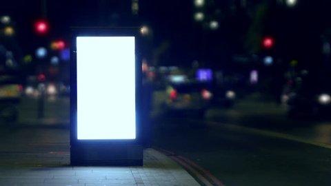 Street billboard advert illuminated sign at night