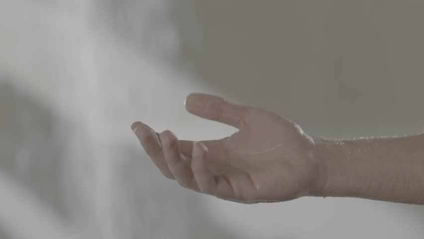 A hand on shower slow motion shampoo falling  | Shutterstock HD Video #1018171720