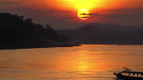 Silhouette Landscape of the Mekong River with sunset cruise