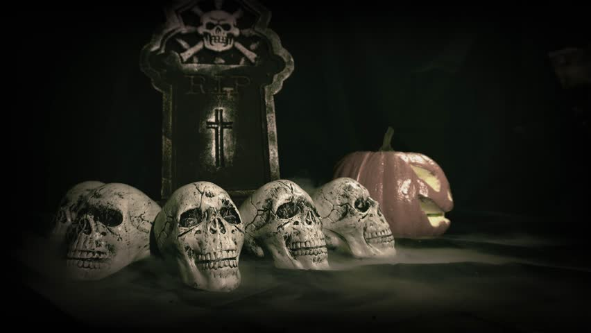 Old film look of halloween set decoration with skulls, grave and jack o'lantern   Shutterstock HD Video #1018184710
