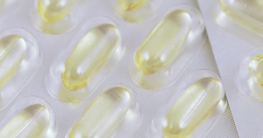 Fish oil fortified Omega3 in pharmacological blisters | Shutterstock HD Video #1018187200