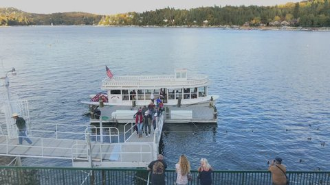 Lake Arrowhead, CA / USA - Oct. 20, 2018: In a time-lapse view, the Arrowhead Queen scenic tour paddle boat is shown being boarded and departing during a late afternoon day on Lake Arrowhead.