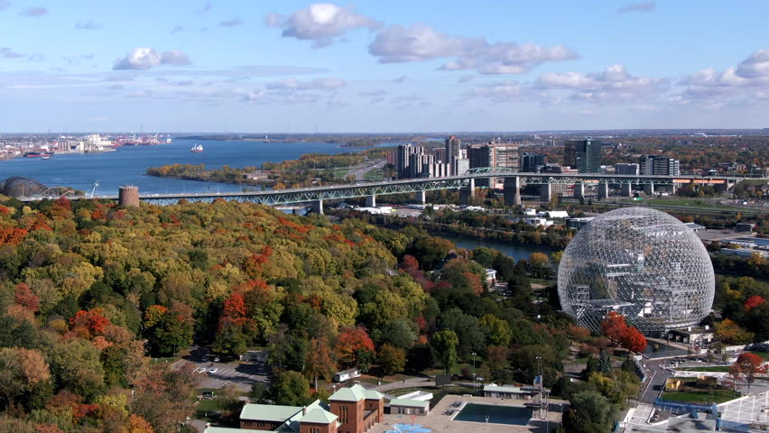 Montreal, Quebec, Canada, aerial view of Biosphere Environment Museum and Saint Lawrence River in the Fall season, daytime. | Shutterstock HD Video #1018203100