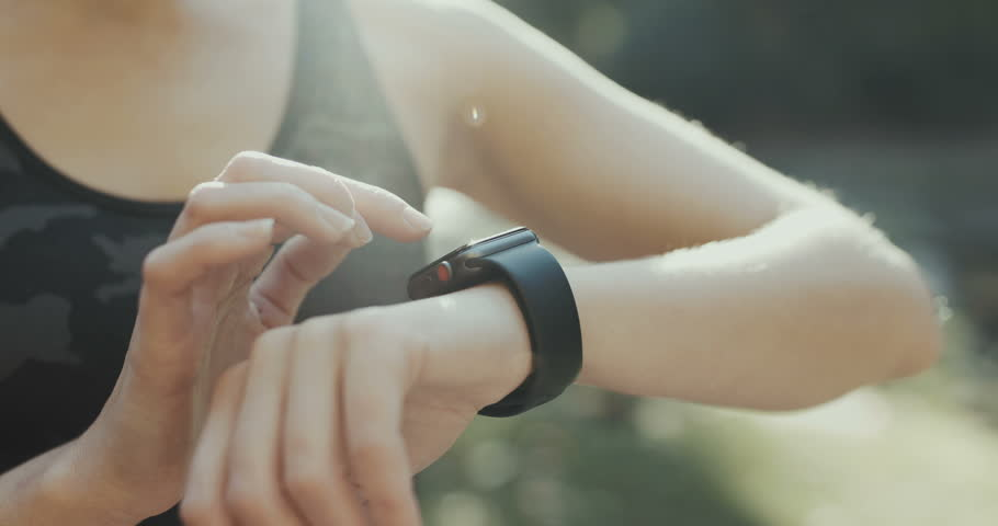 Young woman trying new smart watch. Smart watch. Woman Using Smart Watch and Smart Phone. Closeup | Shutterstock HD Video #1018253860