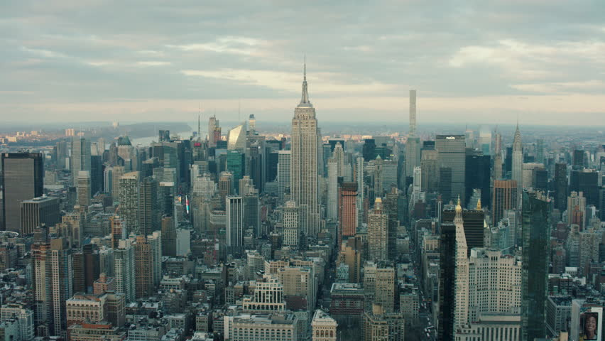 Aerial view of skyscrapers and buildings in Manhattan, New York City skyline, day light in the winter. Wide shot. 4k shot with a RED camera.