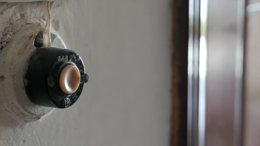 HD A finger presses oldfashion doorbell | Shutterstock HD Video #1018358590