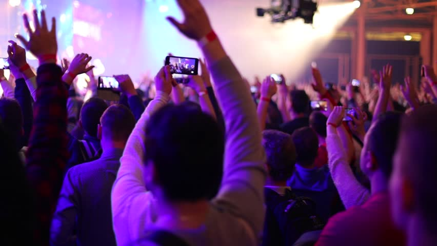People partying at live music concert. Hands up, applause. Slow motion, steadicam shot #1018379680