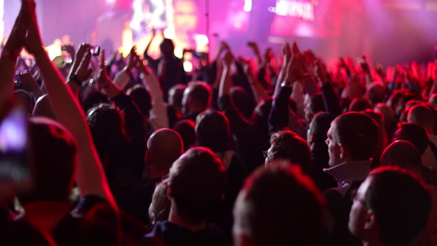 People applaud at live music concert. Slow motion, steadicam shot | Shutterstock HD Video #1018379860