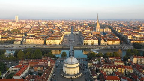 Turin skyline aerial view fly over city centre view of bridge and most pupular square in torino city italy.