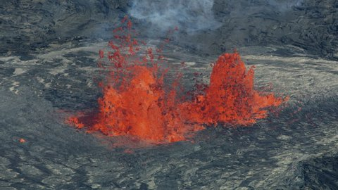 Aerial view fountains of red hot magma spewing from fissures deep in the earth with lava rock solidifying on cooling natural phenomenon Hawaii USA RED WEAPON