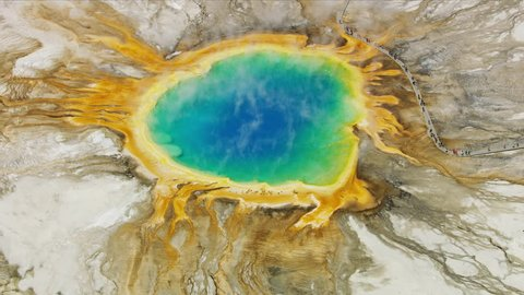 Aerial view of the geothermal Midway geyser basin Yellowstone National Park Grand Prismatic Spring vivid colors and mineral rich water Wyoming USA RED WEAPON