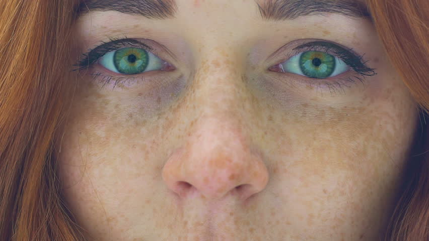 Beautiful woman face with freckles red hair green eyes zoom in extreme close up | Shutterstock HD Video #1018452940