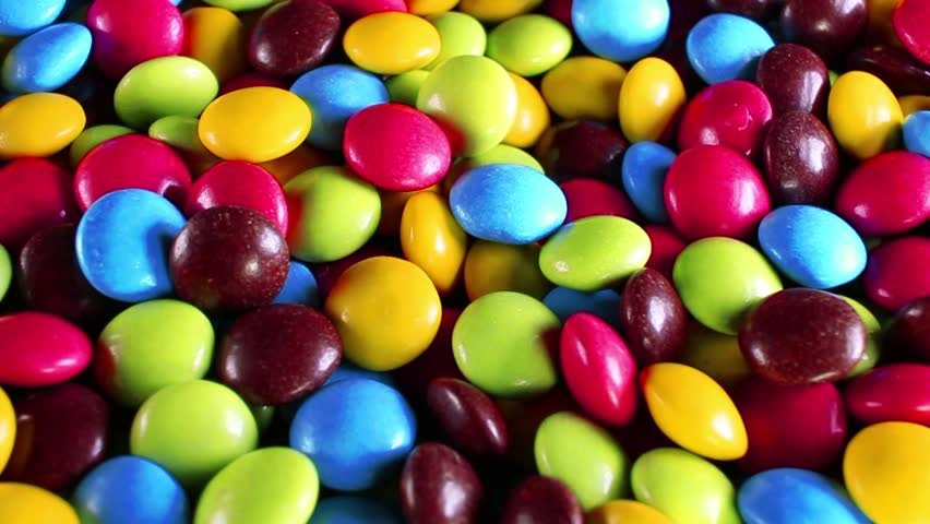 Colorful candy candies rotating texture pattern closeup footage   Shutterstock HD Video #1018456660