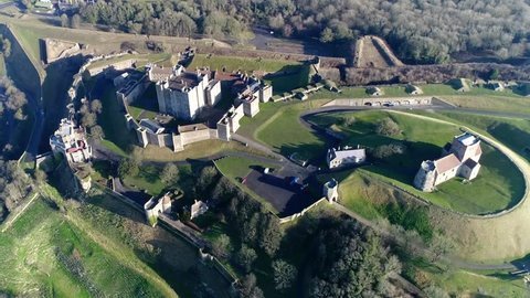 "Aerial footage of Dover Castle is medieval building in Kent England it was founded in 11th century and has been described as ""Key to Britain"" due to its defensive significance throughout history 4k"