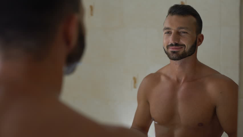 Macho man applying antiperspirant to armpit, preparing to workout in gym | Shutterstock HD Video #1018642150