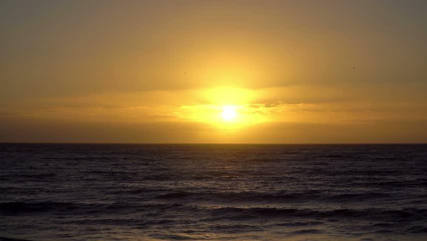 Sun rising over the sea at sunrise. 4K Ultra HD | Shutterstock HD Video #1018690060