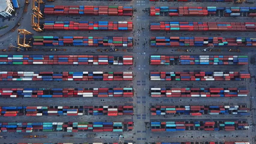 Aerial top view of container cargo ship in the export and import business and logistics international goods in urban city. Shipping cargo to the harbor by crane. | Shutterstock HD Video #1018735060
