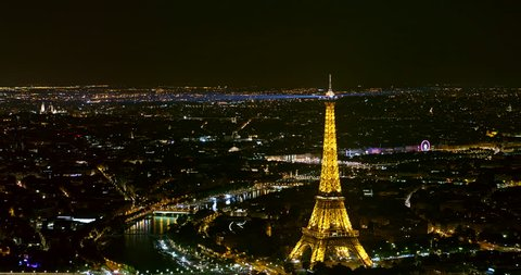 France Paris Aerial Night birdseye view of illuminated Eiffel Tower panning west 8/18