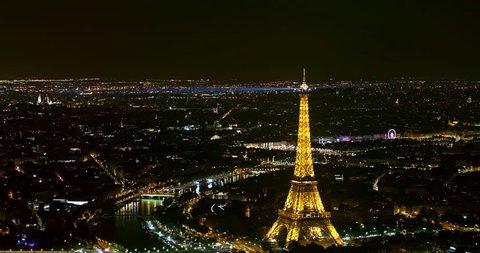 France Paris Aerial Night birdseye view of illuminated Eiffel Tower panning west 8/18