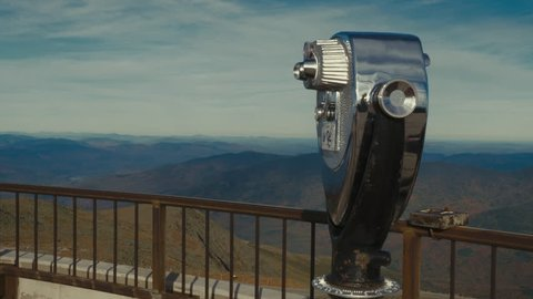 View of an old coin-operated binoculars at the viewing platform on mountain top. 4K UHD