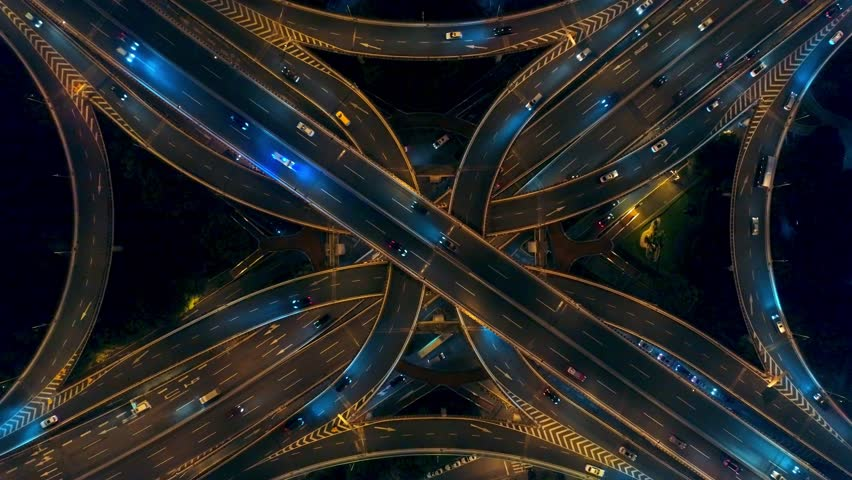 Yananlu Road overpass bridge zoom out with traffic at night aerial view from drone in Shanghai, China. #1018867390