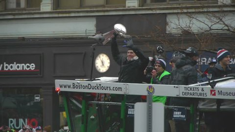 Boston, MA/USA - February 7th 2017 Tom Brady holds up Vince Lombardi trophy at 2017 New England Patriots Superbowl parade in Boston