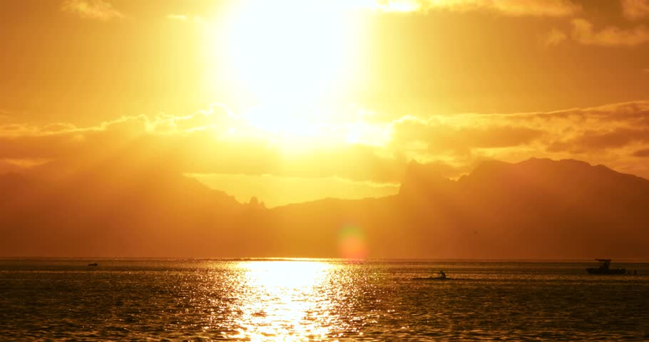 Boat and canoe with Sunset in french polynesia | Shutterstock HD Video #1018944340