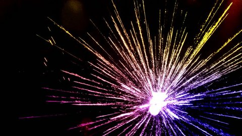Golden Firework display. Fireworks at New Year with beautiful bokeh on background, abstract holiday celebration background. Fireworks from top. Fireworks shot on drone.  Fireworks from above.