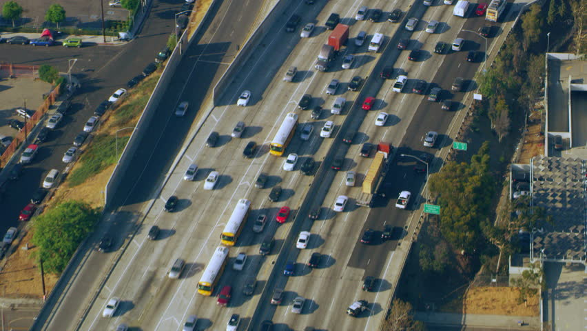 Aerial view of downtown LA traffic on the freeway on a sunny day in Los Angeles, California. Shot on 4K RED camera.