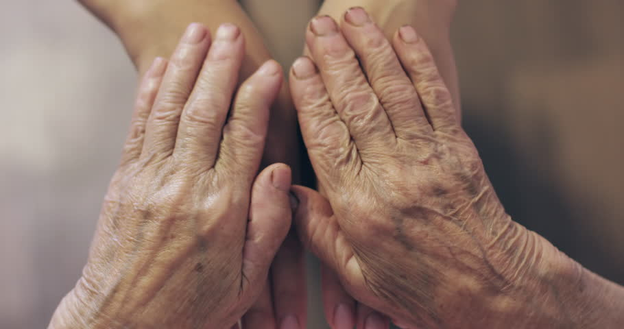 Close-up hands of generations. Old hands with wrinkles are touching the hands of a young woman. Grandma's hands.  | Shutterstock HD Video #1019035000