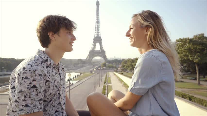 Young couple having fun in Paris city near the Eiffel Tower enjoying summer in the capital city, Europe travel | Shutterstock HD Video #1019095090