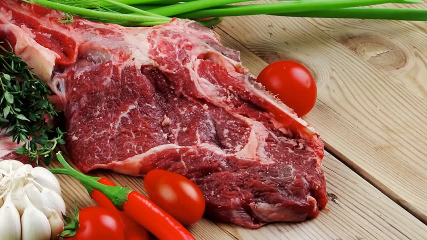 Fresh raw meat : fresh red beef ribs with thyme red chili pepper cherry tomato and garlic on wooden board 1920x1080 intro motion slow hidef hd | Shutterstock HD Video #10191440