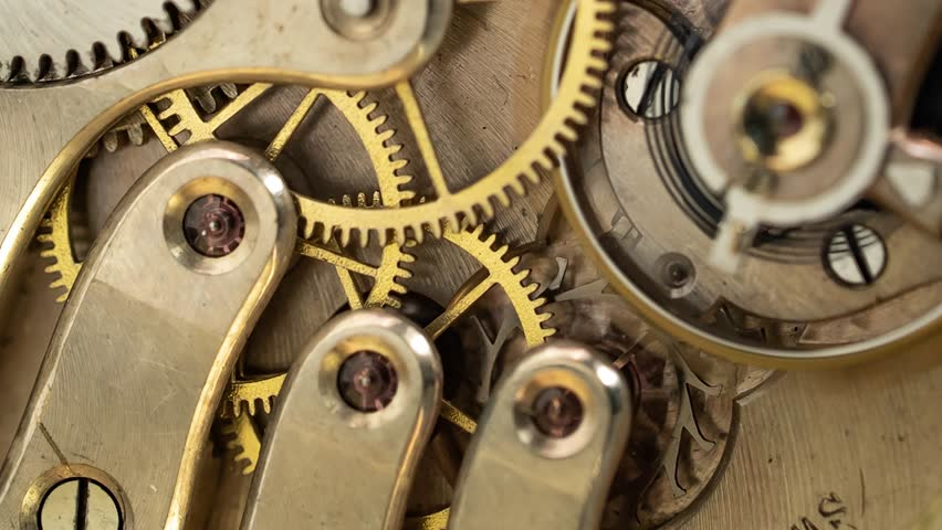 Vintage pocket old clock mechanism working. Close up. Time lapse