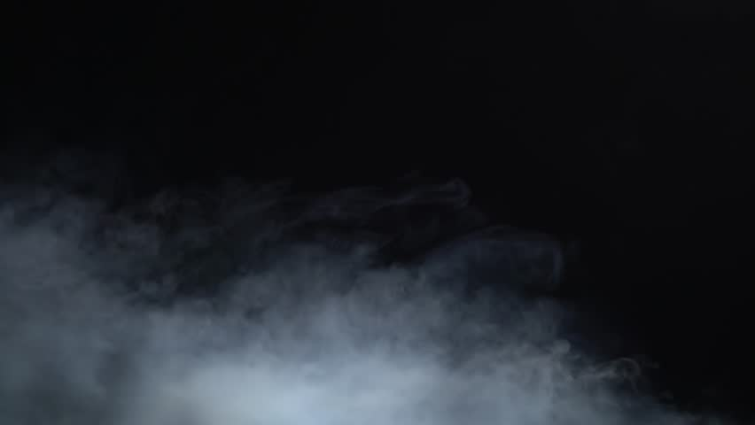 White steam rises on a black background | Shutterstock HD Video #1019251300