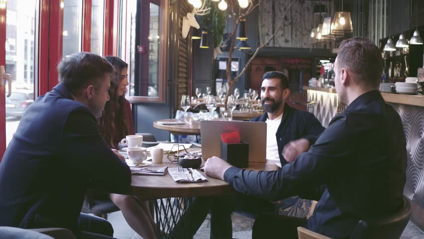 Group Young Business People Gathered Together Discussing Creative Idea at Cafe. Startup Concept Coworkers Meeting.Brainstorming Work Process Office.Using Modern Electronics Gadgets.   Shutterstock HD Video #1019295550