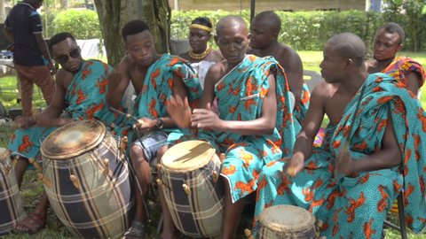 Accra, Ghana - November 10 2018: Traditional African drumming and dancing at a festival in West African.