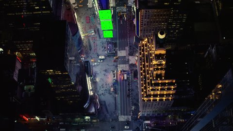 Top down aerial view of busy streets in downtown manhattan in times square,  new york city, with bright night lighting  best new york vfx aerial shot   wide shot on 4k red camera with green screens