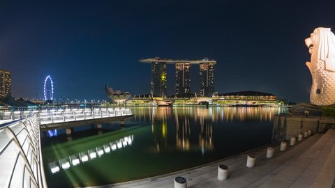 Singapore city, Singapore - April 9, 2018: Singapore city skyline with Merlion Park night to day timelapse