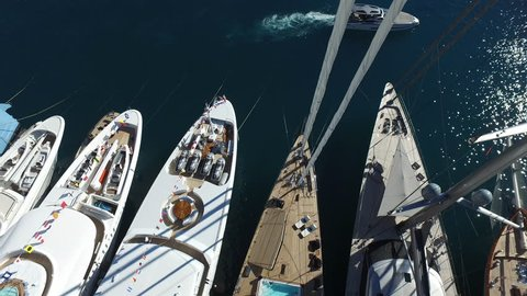 High aspect view of Port Hercules, Monte Carlo during the Monaco Yacht Show.  Camera panning from left to right.