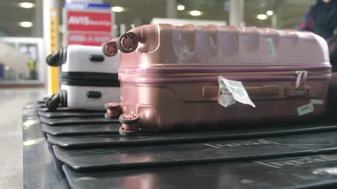Singapore, 13 july 2018. Airport baggage claim with luggage spinning around conveyor. Close up. 3840x2160